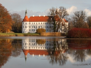 Medieval Castle by a lake in autumn