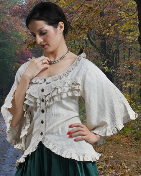 Classic Blouse in a great nubby cotton fabric has ruffles on neckline, front, the weskit hem, and the very full sleeves with