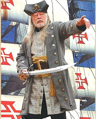 Buccaneer Coat -- captain-style coat of heavy gray wool, bell sleeves, antiqued buttons, black rayon lining.
