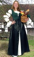 Tavern Frock has green brocade lace-up bodice and attached black overskirt