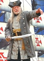 Bucaneer coat in grey, shown with long vest, wide pirate belt and tasseled pirate sash