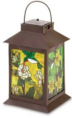 Solar-powered, metal and glass  floral lantern creates a stained glass effect when lighted. 11.75 inches tall.