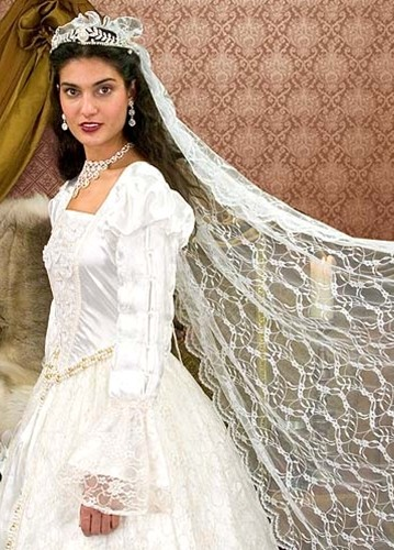 White satin and lace Renaissance wedding gown trimmed with hand-made flowers and artificial pearls, comes with 60-inch floral lace veil.