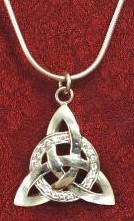 Jeweled Celtic Pendant has Celtic knotwork on a circle of faux diamonds, sterling silver on 18 inch silver snake chain.