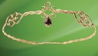 Circlet crown in antiqued brass wire with faux onyx teardrop stone set in front.