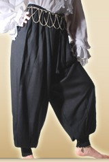 Black pirate or harem pants, very full at hips.
