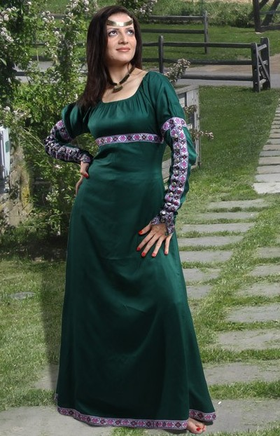 Medieval gown in hunter green with floral trim on sleeves, bodice and hemline. Also available in black