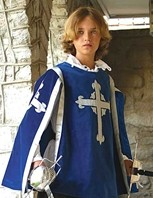 Blue cotton velvet Musketeer tabard with silver Musketeer cross on front and back, silver trim, matching rayon lining.