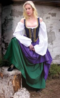 Two gathered skirts, with top skirt hiked, purple and green