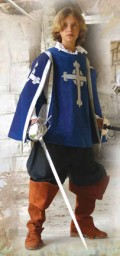 Boys Musketeer Tabard in blue velvet with silver trim and embroidered silver crosses.