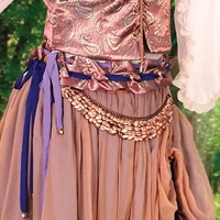 Gypsy Queen Belt made of hundreds of gleaming copper-plated disks on a metal chain.