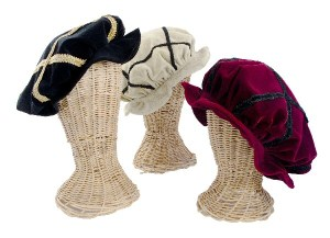 Authentically designed Italian Renaissance style bonnets in velvet with braid trim.