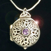Sterling silver locket with open interlaced celtic knots, a faux amethyst and sterling silver  chain.  Space inside to carry a small treasure.