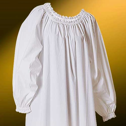 Lace-trimmed Chemise has delicate white lace trim on the neck and sleeves, plus white on white floral embroidery on the skirt.