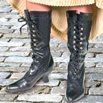 Ladies high boots in black simulated leather with black lace inserts.