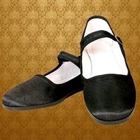 Lady Jane Shoe in black silk with rubber sole, adjustable strap with nickel-plated buckle.