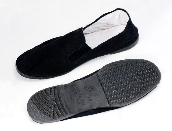 Mans slip on style shoe in black cotton canvas with rubber sole