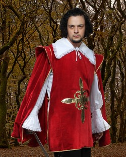 Red velvet musketeer tabard withn gold emblem on chest and gold trim